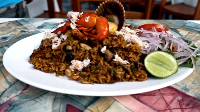 peruvian seafood rice - crab stock videos and b-roll footage