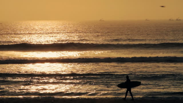 peruvian surfer during sunset hour - peru stock videos & royalty-free footage