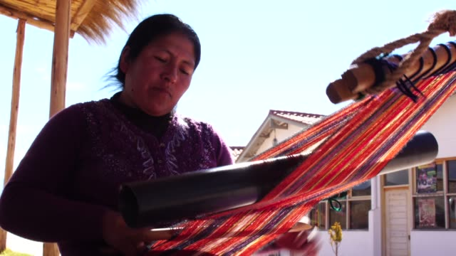 peruvian young woman weaving - peruvian ethnicity stock videos & royalty-free footage