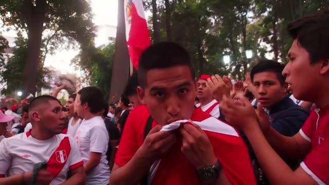 stockvideo's en b-roll-footage met peruvians celebrate after the fifa world cup 2018 qualification playoff second leg match between peru and new zealand on november 15 2017 in lima... - fifa wereldkampioenschap