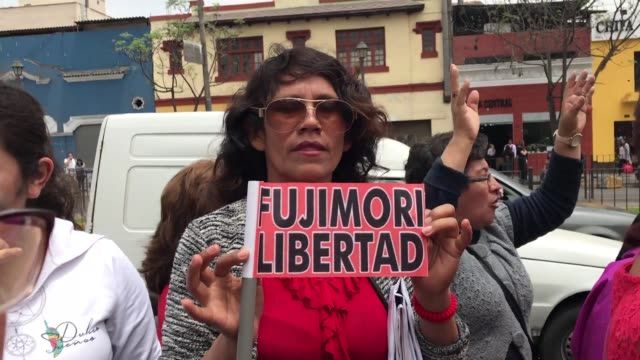peruvians protest in front of a police station in lima in support of keiko fujimori the opposition leader and daughter of disgraced ex president... - peruvian ethnicity stock videos & royalty-free footage