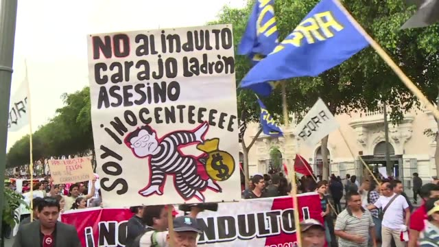 Peruvians take to the streets on Thursday against the decision of President Kuczynski to pardon former leader Alberto Fujimori who had been serving a...