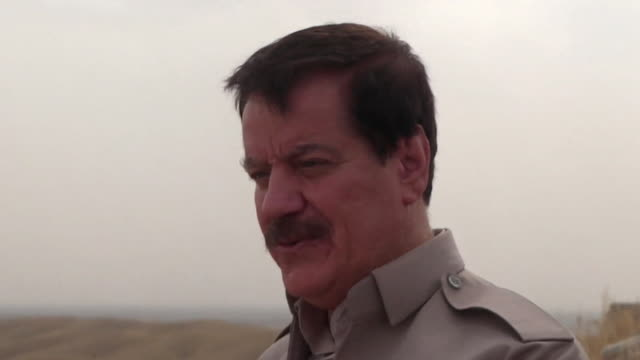 vídeos de stock, filmes e b-roll de peshmerga commander kemal kirkuki says that the peshmerga will continue to fight isis until they are no longer in the area [regardless of the outcome... - curdo