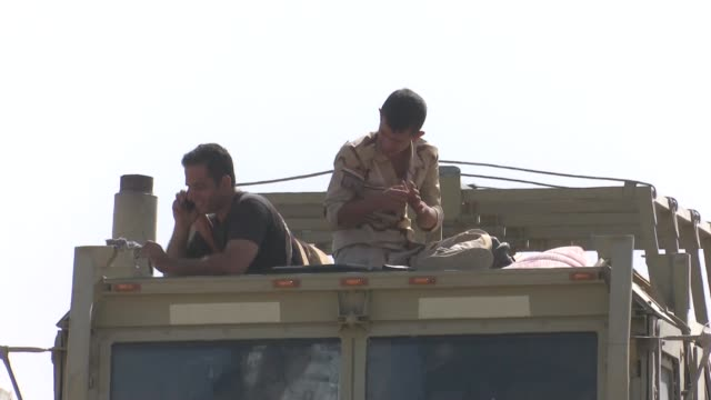 Peshmerga forces disallow the passing of military shipment vehicles belong to military unit loyal to Iraqi army to Bashiqa due to Shiite flags during...