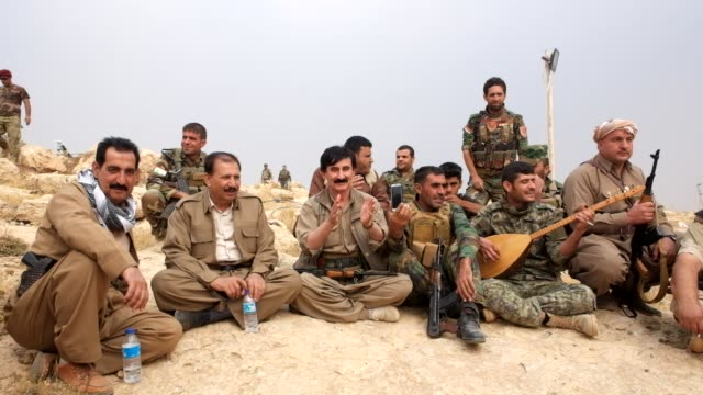 stockvideo's en b-roll-footage met peshmerga forces on the top of bashiqa mountain playing music on october 27 2016 - isis