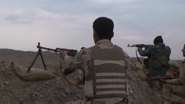 peshmerga security forces stand guard at a trench against possible attacks of islamic state of iraq and levant members outside the harabaru village... - eventuell stock-videos und b-roll-filmmaterial
