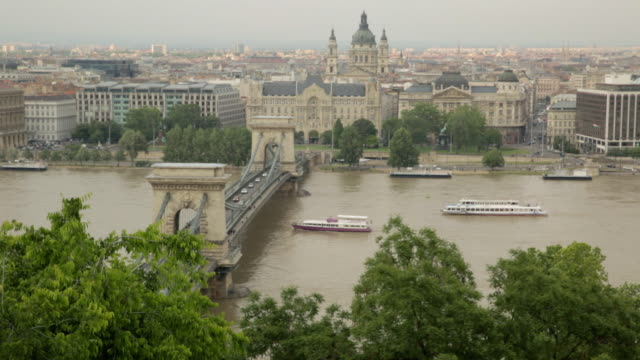 pest, the river danube, and the szã©chenyi chain bridge - széchenyi chain bridge stock videos and b-roll footage