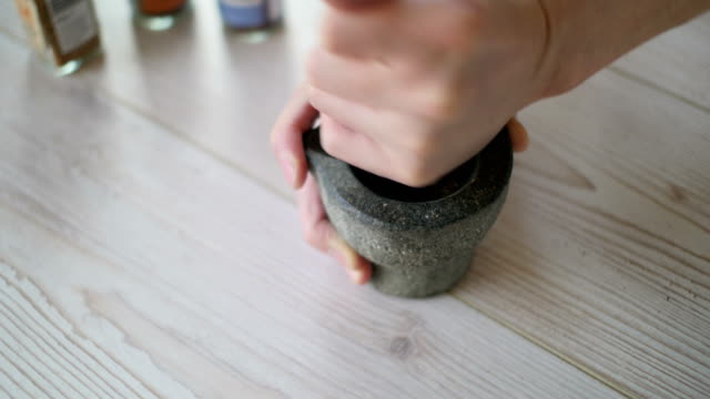 pestle mixed peppercorns and rock salt - mortar and pestle stock videos and b-roll footage