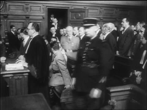 petain in uniform entering courtroom for war crimes trial / paris / newsreel - war crimes trial stock videos and b-roll footage