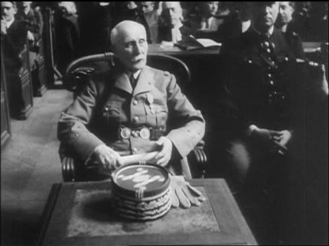 petain sitting in courtroom during war crimes trial paris / newsreel - war crimes trial stock videos and b-roll footage