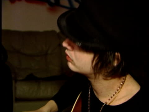 pete doherty interview close mid shots doherty strumming guitar - plucking an instrument stock videos and b-roll footage