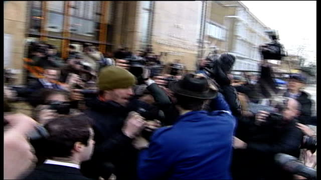 pete doherty returns to court for second day in a row; england: london: ext press towards car pulling up outside court pete doherty out of car... - day 2 stock videos & royalty-free footage