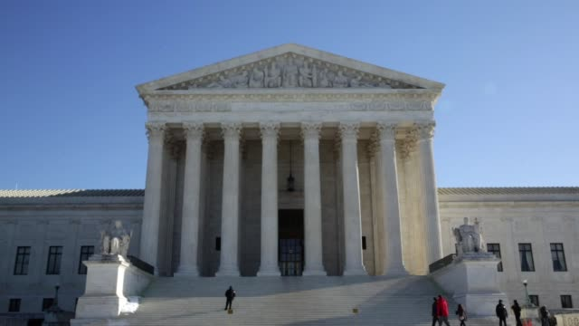 Pete Prete of Equality Beyond Gender flies a 'marriage pride flag' outside the US Supreme Court The nine justices of the Supreme Court were scheduled...