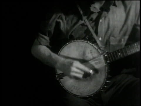 pete seeger finishes a song on his banjo and greets his audience - banjo stock videos & royalty-free footage