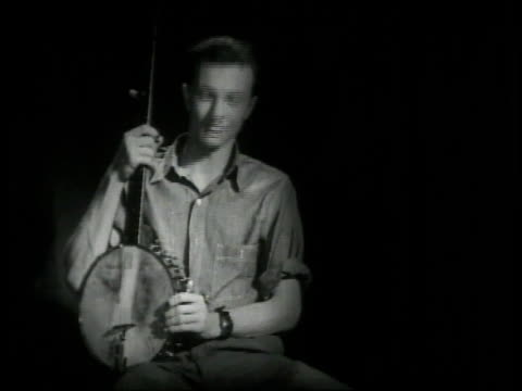 pete seeger playing banjo and talking about music / new york united states - banjo stock videos & royalty-free footage