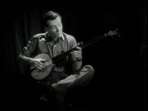 pete seeger talking about country music and playing his banjo / new york city new york united states - banjo stock videos & royalty-free footage