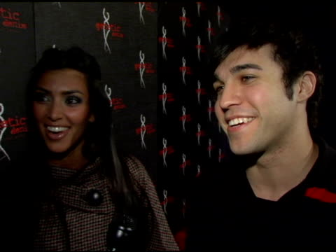 "pete wentz and kim kardashian on jeans as fashion statements jeans making their ""booties"" look good and her clothing store at the genetic denim's... - 2006 stock videos & royalty-free footage"