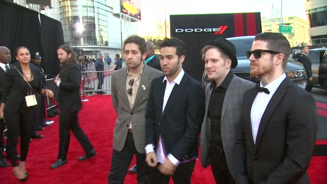 Pete Wentz Joe Trohman Patrick Stump and Andy Hurley of the band Fall Out Boy attend the 2013 American Music Awards Powered By Dodge