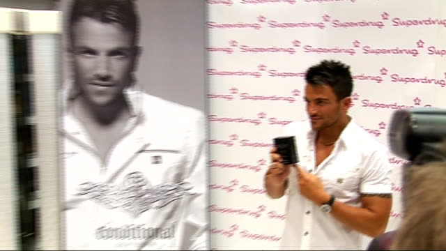 peter andre fragrance launch in london; england: west london: westfield shopping centre: int general views peter andre promotional posters ** flash... - window box stock videos & royalty-free footage
