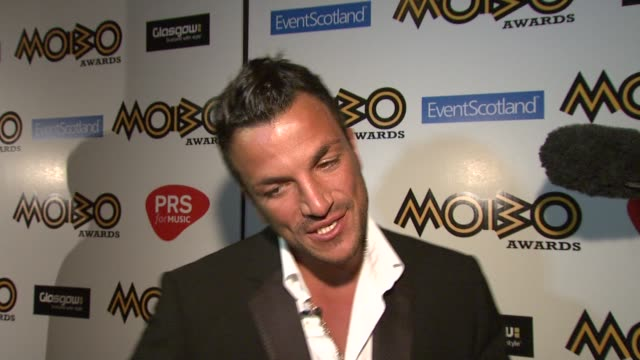 peter andre on what the mobos mean to him and the influences on his music on who he's supporting on how his album and single is going on why he's... - アルバムのタイトル点の映像素材/bロール