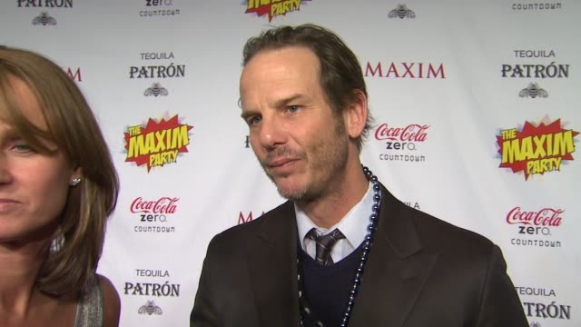 peter berg with katie bayne on what brings him out the the maxim super bowl party what super power he would most like to have who he thinks is the... - paul mitchell stock videos and b-roll footage