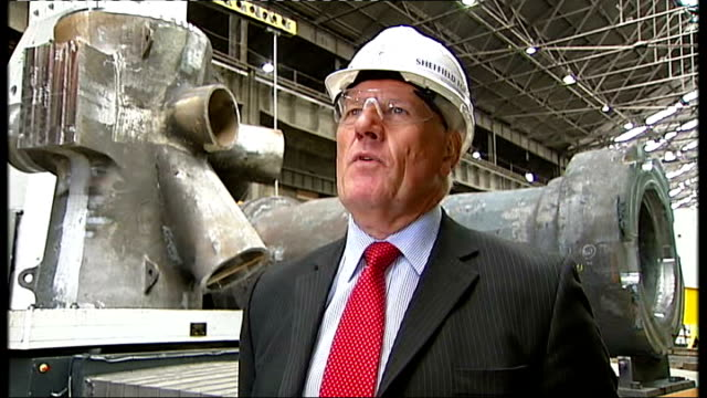 vídeos de stock, filmes e b-roll de peter birtles interview sot giant claw carrying ball of red hot steel factory worker monitoring movement of robotic claw worker in control room... - sheffield