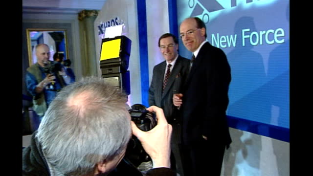 stockvideo's en b-roll-footage met photography *** peter burt and sir james crosby deputy chairman financial services authority in photocall at announcement of halifax and bank of... - channel 4 news