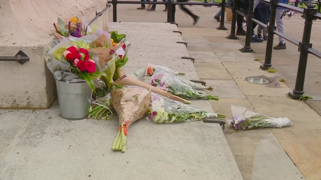 8th arrest made ENGLAND NewcastleuponTyne EXT Men embracing close to the scene of the murder of Peter Duncan Flowers laid in memory of Peter Duncan...