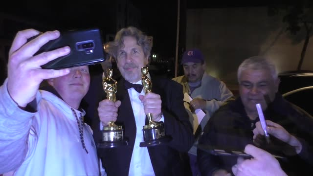 peter farrelly poses with his best picture & best screenplay award for green book outside craig's restaurant in west hollywood in celebrity sightings... - 映画賞点の映像素材/bロール
