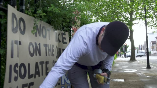 peter liversidge cleans signs he created to support key workers during the coronavirus on may 27, 2020 in london, england the british government... - repetition stock videos & royalty-free footage