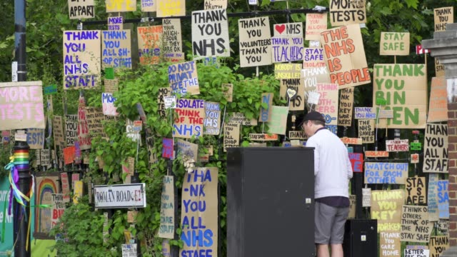 peter liversidge cleans signs he created to support key workers during the coronavirus on may 27 2020 in london england the british government... - art and craft stock videos & royalty-free footage
