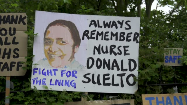 vídeos de stock e filmes b-roll de peter liversidge cleans signs he created to support key workers during the coronavirus on may 27, 2020 in london, england the british government... - plus key