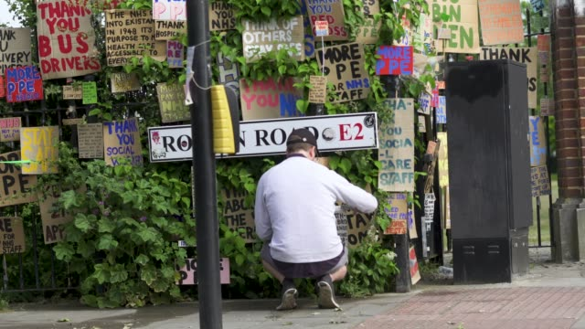 peter liversidge cleans signs he created to support key workers during the coronavirus on may 27 2020 in london england the british government... - addition key stock videos & royalty-free footage