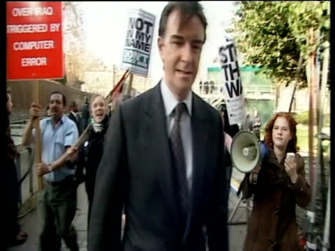 Peter Mandelson MP is mobbed by anti war protestors as he walks to car London 18 Mar 03