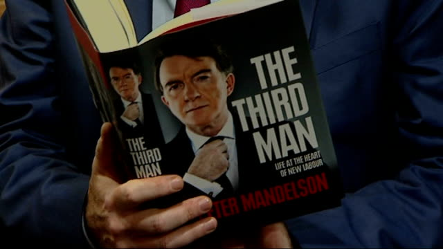 peter mandelson publishes controversial memoir england london photography** close shot of lord mandelson posing for photocall with copy of his memoir... - biographie stock-videos und b-roll-filmmaterial
