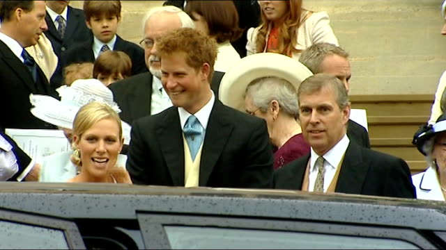 Windsor St George's Chapel EXT Peter Phillips down steps of chapel with bride Autumn Kelly and into carriage watched by guests including Queen...