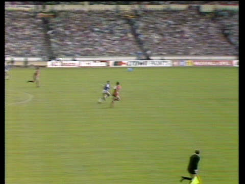 Peter Reid plays long ball behind Liverpool defence Gary Lineker outpaces Alan Hansen to ball Lineker's shot parried by Bruce Grobbelaar rebounds...