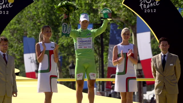 peter sagan on the podium on the champs elysees on stage 20 of 2012 tour de france - tour de france stock videos & royalty-free footage