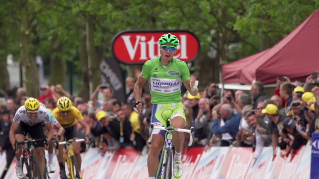 peter sagan pumping his arms forest gump style as he crosses the finish line after winning stage 3 of 2012 tour de france - tour de france stock videos & royalty-free footage