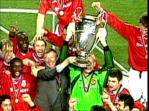 stockvideo's en b-roll-footage met peter schmeichel out plane holding up european champions league cup - 1999