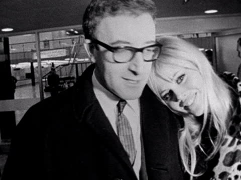 peter sellers and britt ekland kiss and pose for photographers at london airport. 1964. - celebrities stock videos & royalty-free footage