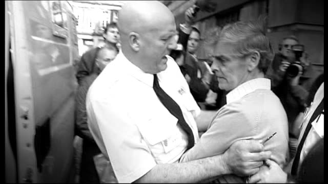 peter tobin convicted of dinah mcnicol murder lib linlithgow police leading handcuffed peter tobin along to police van - linlithgow stock videos and b-roll footage