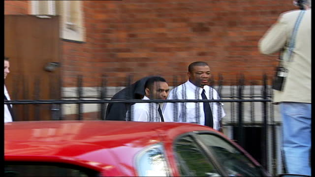 bradley tucker charged: tucker to security van; england: london: barking: barking magistrates court: ext crowd gathered outside court / bradley... - tucker stock videos & royalty-free footage
