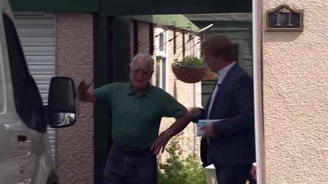campaigning england cambridgeshire peterborough ext mike greene interview sot paul bristow calling at house as canvassing man tells him he is... - nachwahl stock-videos und b-roll-filmmaterial