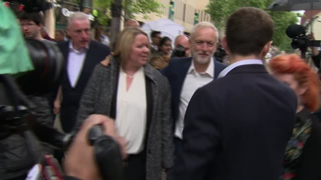 labour wins seat england cambridgeshire peterborough ext jeremy corbyn mp along road with lisa forbes mp various shots of corybn and forbes arriving... - nachwahl stock-videos und b-roll-filmmaterial