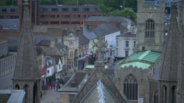 labour wins seat england cambridgeshire peterborough ext peterborough cathedral seen through archway tilt down high angle view of city centre st john... - nachwahl stock-videos und b-roll-filmmaterial