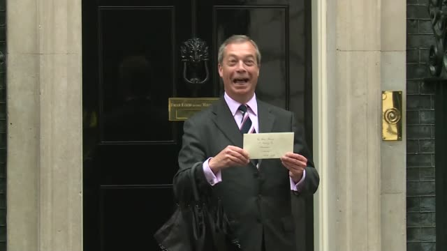 labour wins seat england london downing street ext various shots of nigel farage mep posing for photocall holding letter outside number 10 and... - nachwahl stock-videos und b-roll-filmmaterial