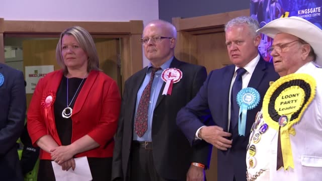 labour wins seat vote declaration cutaways england cambridgeshire peterborough shot following lisa forbes along corridor / candidates arriving on... - nachwahl stock-videos und b-roll-filmmaterial