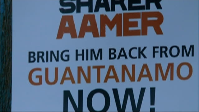 petition calling for release of guantanamo prisoner shaker aamer int close shot of 'we stand with saker aamer' campaign poster joanne macinnes... - shaker aamer stock videos & royalty-free footage