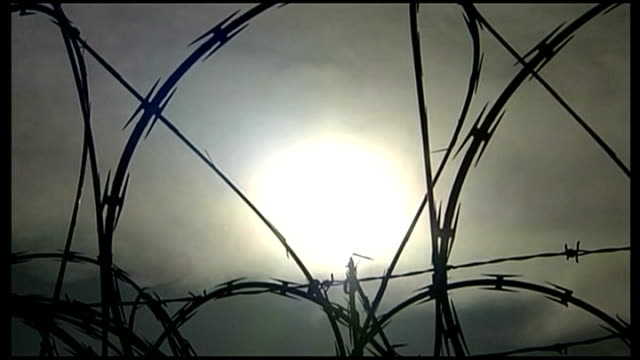 petition calling for release of guantanamo prisoner shaker aamer; r12090610 / 12.9.2006 cuba: guantanamo bay naval base: camp delta ext razor wire... - petition stock videos & royalty-free footage